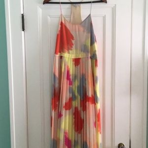 1. State multicolored dress with pleated skirt